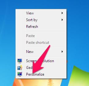 Nhấn chuột phải lên màn hình desktop chọn Personalize