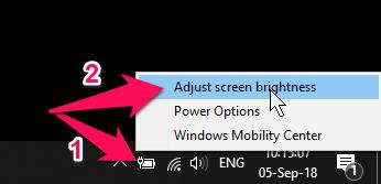 Nhấn chuột phải lên biểu tượng pin trên thanh taskbar chọn Adjust screen brightness