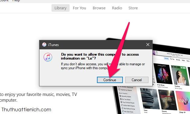 Mở ứng dụng iTunes trên máy tính, nếu được hỏi Bạn có muốn cho phép máy tính này truy cập iPhone không thì nhấn Continue